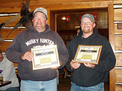 Dale and a friend with a fishing award